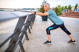 Woman stretching on a jog