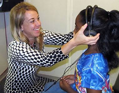 Girl getting hearing evaluation